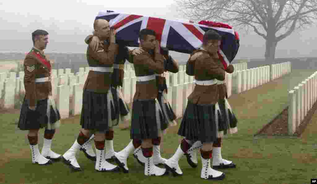 Military pallbearers carry the casket of British World War I soldier William McAleer during a reburial service at the Loos British World War I cemetery in Loos-en-Gohelle, France. Private William McAleer of the 7th Battalion, Royal Scots Fusiliers was killed in action on Sept. 26, 1915 during the Battle of Loos. His body was found and identified in 2010 during routine construction in the area and is being reburied with full military honors along with 19 unknown soldiers.