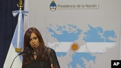 Argentina's President Cristina Fernandez stands in of front of a Falklands Islands' map at Government Palace in Buenos Aires, Argentina, February 7, 2012.