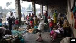 Internally displaced people find refuge in an empty building in an impromptu refugee camp in Kibati, north of Goma, eastern Congo, Monday Aug. 6, 2012. Doctors Without Borders (MSF)'s Christian Masudi said the lack of hygiene, the overpopulation of the ar