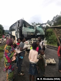 FILE - A bus attacked by armed separatist is seen at Akum, a village 10 Kilometers from Bamenda, capital of the Cameroon's English-speaking northwest region, Sept. 9, 2018.