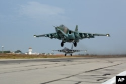 Russian Su-25 jets takes off for a mission from Hemeimeem airbase in Syria, October 22, 2015.