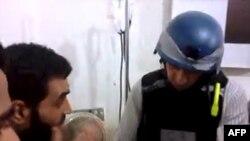 Bir BM denetçisi Modamiye banliyösündeki hastanede kimyasal silah saldırısıyla ilgili bilgi toplarken