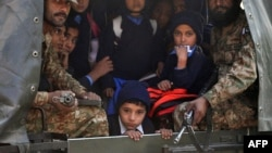 Pakistani soldiers transport rescued school children from the site of an attack by Taliban gunmen on a school in Peshawar, Dec. 16, 2014.