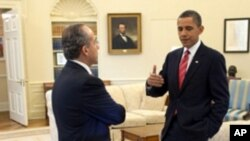 President Barack Obama and President Felipe Calderón of Mexico confer in the Oval Office, before their joint press conference in the Rose Garden of the White House, May 19, 2010