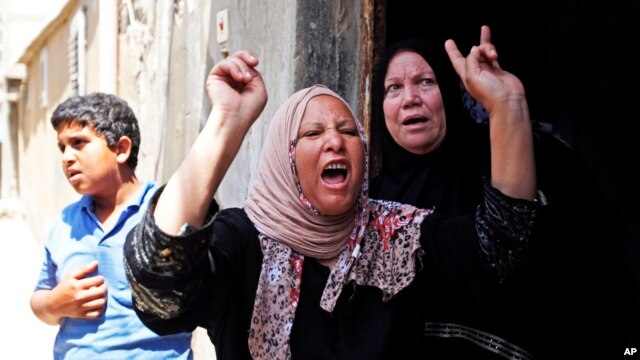 Palestinian relatives of Haitham Mishal, 29, react during his funeral in the Shati Refugee Camp in Gaza City, April 30, 2013.