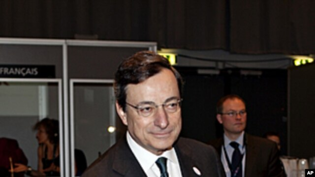 European Central Bank President Mario Draghi, takes his seat  during  the informal EU-meeting for EU Finance Ministers, in Copenhagen, Denmark, March 30 2012.