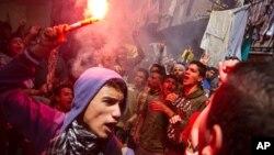 지난 4월 이집트 카이로에서 무함마드 무르시 전 대통령을 지지하는 시위대가 가두행진을 벌이고 있다. (자료사진)
