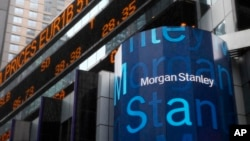 FILE - A Morgan Stanley billboard is displayed in Times Square, New York, Jan. 18, 2011. Morgan Stanley plans to offer savings accounts and certificates of deposits next year to wring more profit from its wealth management clients, executives told Reuters