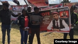 MDC youths carrying a banner with Ostallos Gift Siziba's image.
