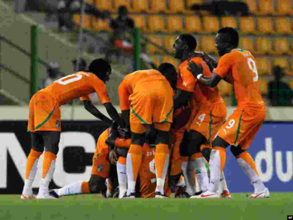 Ivory coast's players celebrate after scoring against Burkina Faso during their African Nations Cup soccer match in Malabo