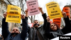 FILE - Journalists demanding greater media freedom are seen at a rally against Turkey's ruling AK Party in Ankara.