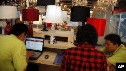 """购物网站""""淘宝""""的员工检验公司网页资料照"""