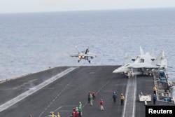 A U.S. Navy F/A-18C Hornet launches from the flight deck of aircraft carrier USS Harry S. Truman in the Mediterranean Sea, June 3, 2016. U.S. Navy/Mass Communication Specialist 3rd Class Bobby J Siens/Handout via Reuters.