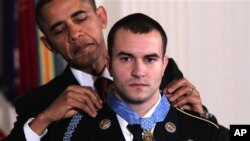 President Barack Obama presents the Medal of Honor to Staff Sgt. Salvatore Giunta, who rescued two members of his squad in October 2007 while fighting in the war in Afghanistan, 16 Nov 2010