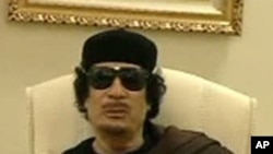 Muammar Gaddafi gestures as he speaks at a Tripoli hotel in this still image from a video by Libyan TV released May 11, 2011.