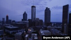 Clouds roll into downtown Atlanta on Wednesday, Aug. 11, 2021. (AP Photo/Brynn Anderson)