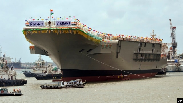 The Indian aircraft carrier is docked at a shipyard after its launch in Kochi, India, Aug. 12, 2013.