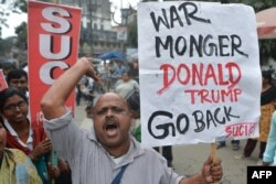 Activists of Socialist Unity Centre of India (Communist) shout slogans as they protest against US President Donald Trump's visit to India, in Siliguri February 24, 2020.
