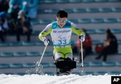 Kim Jong Hyon of North Korea competes in the qualification round, March 14, 2018, of the men's 1.1 km sprint, sitting, cross-country skiing at the 2018 Winter Paralympics in Pyeongchang, South Korea.