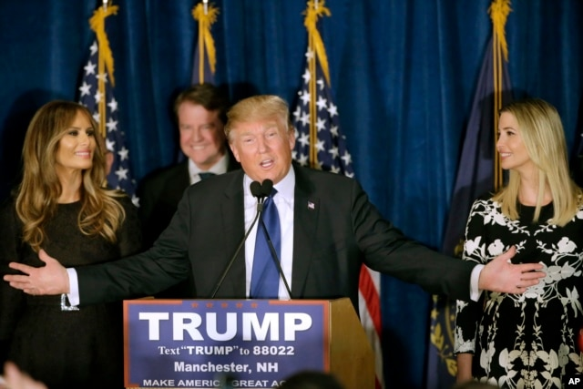 Republican presidential candidate, businessman Donald Trump speaks to supporters during a primary night rally, Tuesday, Feb. 9, 2016, in Manchester, N.H. At his side are his wife Melania Trump, left, and daughter Ivanka Trump, right.