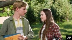 "CALLAN McAULIFFE as Bryce Loski and MADELINE CARROLL as Juli Baker in Castle Rock Entertainment's coming-of-age romantic comedy ""FLIPPED,"" a Warner Bros. Pictures release."
