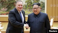 FILE - North Korean leader Kim Jong Un shakes hands with U.S. Secretary of State Mike Pompeo, May 9, 2018, released by North Korea's Korean Central News Agency in Pyongyang.