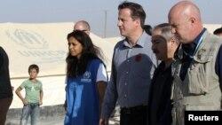 Britaniya Bosh vaziri Deyvid Kameron Iordaniyada suriyalik qochqinlar shaharlarini ko'zdan kechirdi.