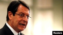 Cyprus President Nicos Anastasiades addresses a conference of civil servants in Nicosia, March 29, 2013.