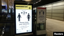 A sign regarding social distancing is seen at the Canary Wharf station, following the outbreak of the coronavirus disease (COVID-19), London, Britain, May 4, 2020. (REUTERS/Adam Oliver)