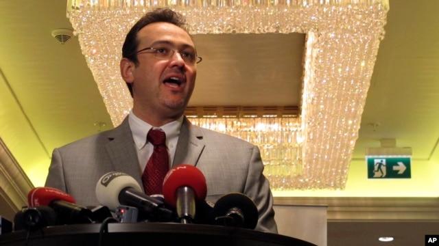 FILE - Syrian National Coalition spokesman Khalid Saleh