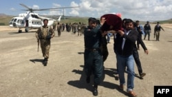 FILE - Relatives carry the coffin of an Afghan National Army soldier killed in a Taliban attack in Takhar province, Afghanistan, April 23, 2017. On Thursday, a Taliban raid in Takhar province killed 16 Afghan forces.
