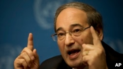 Syrian Deputy Foreign Minister Faisal Makdad gestures during a press briefing at the United Nations headquarters in Geneva, Switzerland, Jan. 26, 2014.
