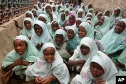 In this photo taken April. 6, 2016 Muslim girls wearing hijab attend lectures in a school in Kano, Nigeria. Nigerian girls have the right to wear the hijab headscarf to school, an appeals court has ruled in a country where suicide bombers have abused Islamic dress to hide their deadly weapons.