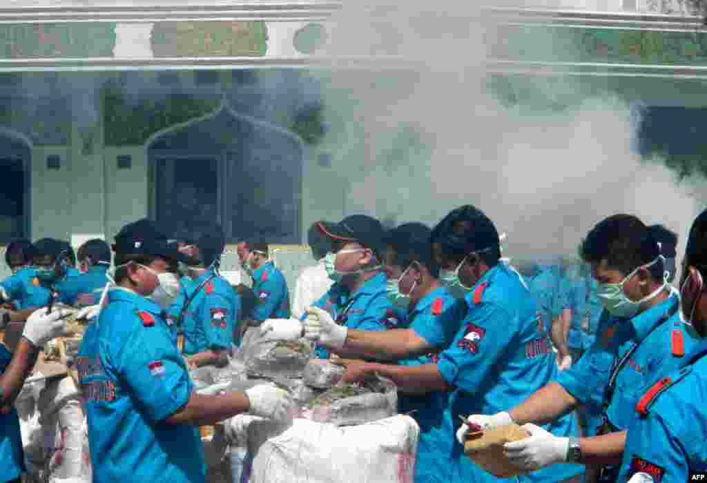 Indonesian narcotics police destroy 1.4 tons of seized marijuana from series of raids in Jakarta.