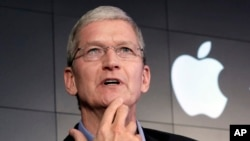 FILE – Apple CEO Tim Cook contends that complying with a government demand to help unlock an iPhone would endanger civil liberties. He's shown at a 2015 news conference in New York.