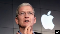 FILE – Apple CEO Tim Cook contends that complying with a government demand to help unlock an iPhone linked to a terrorist attack would endanger civil liberties. He's shown at a 2015 news conference in New York.