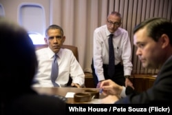 FILE - President Barack Obama holds a meeting with National Security Advisor Susan E. Rice, John Podesta, Counselor to the President and Phil Reiner, Senior Director for South Asian Affairs, aboard Air Force One.