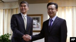 FILE - Hwang Joon-kook, right, South Korea's special representative for Korean Peninsula affairs — shown in Seoul last year with U.S. Special Representative for North Korea Policy Sung Kim — says exploratory talks will test Pyongyang's will to denuclearize.