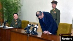 One of the two men whom North Korea identified as being South Korean and accused of being a spy for South Korea bows during a news conference in Pyongyang, in this undated photo released by North Korea's Korean Central News Agency (KCNA) in Pyongyang, Mar