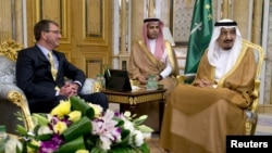 U.S. Defense Secretary Ash Carter meets with Saudi Arabia's King Salman bin Abdul Aziz, right, at Al-Salam Palace in Jeddah, Saudi Arabia, July 22, 2015.