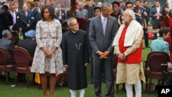 FILE - U.S. President Barack Obama, second right and first lady Michelle Obama, left stand with Indian Prime Minister Narendra Modi, right and Indian President Pranab Mukherjee.