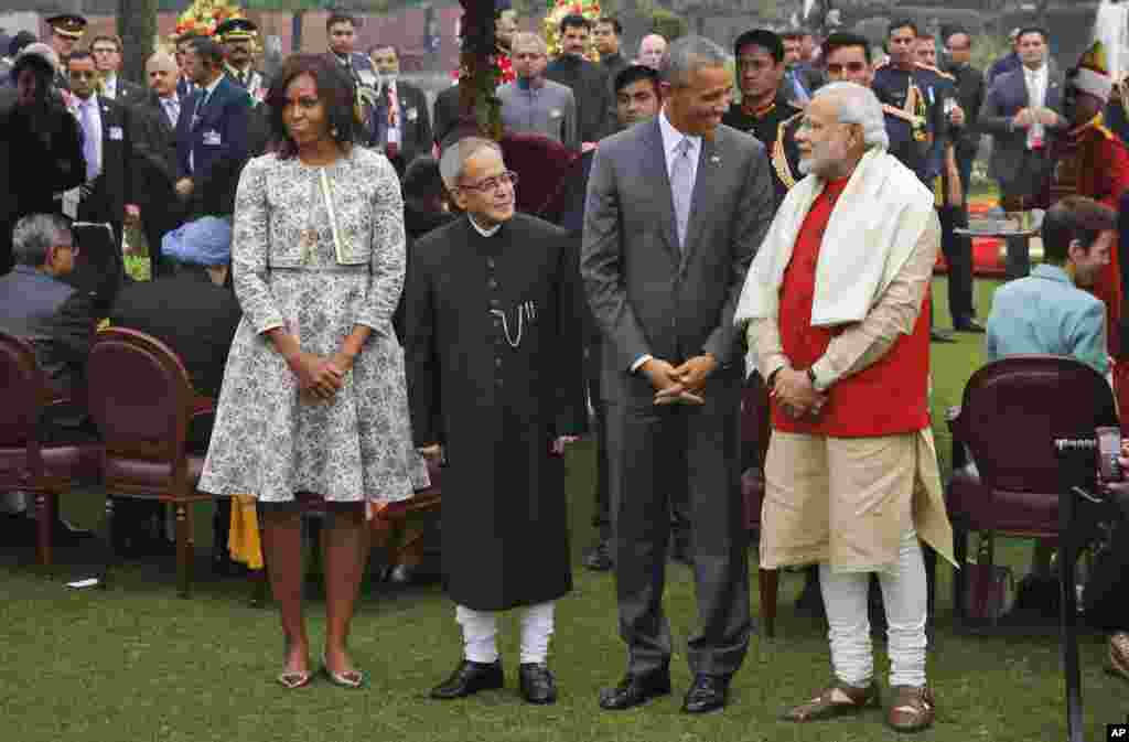 U.S. President Barack Obama, second right and first lady Michelle Obama, left stand with Indian Prime Minister Narendra Modi, right and Indian President Pranab Mukherjee during a photo op at a reception hosted by Mukherjee on India's Republic Day at the presidential palace in New Delhi, India.