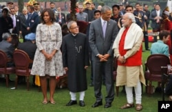 U.S. President Barack Obama, second right and first lady Michelle Obama, left stand with Indian Prime Minister Narendra Modi, right and Indian President Pranab Mukherjee during a photo op at a reception hosted by Mukherjee on India's Republic Day.