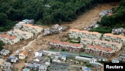 An aerial view shows a landslide that swept through a residential area at Asaminami ward in Hiroshima, western Japan, in this photo taken by Kyodo, Aug. 20, 2014.