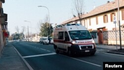 An ambulance is seen driving down a road in San Fiorano, one of the towns on lockdown due to a coronavirus outbreak, in this picture taken schoolteacher Marzio Toniolo in San Fiorano, Italy, February 22, 2020.