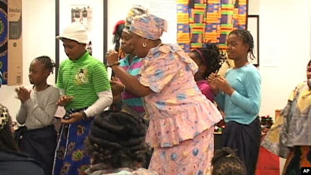 People celebrate Kwanzaa at the Anacostia Community Museum in Southeast Washington