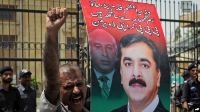 A supporter of the ruling Pakistan Peoples Party (PPP) holds an image of the Pakistan's Prime Minister Yusuf Raza Gilani as he shouts slogans during a protest against a Supreme Court verdict in Karachi, April 26, 2012.