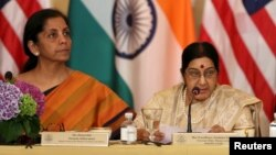 FILE - India's then-minister of commerce and industry, now minister of defense, Nirmala Sitharaman (L) and foreign minister Sushma Swaraj are seen at a U.S-India Strategic & Commercial Dialogue plenary session at the State Department, in Washington, Sept. 22, 2015.
