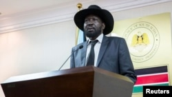South Sudan President Salva Kiir, shown here at a news conference in Juba, says a key word was changed in the Arusha agreement to reunify the Sudan People's Liberation Movement, which fractured when violence erupted in Dec. 2013.