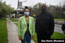 Lanessa Owens-Chaplin, lawyer, and David Rufus, I-81 Project Coordinator, New York Civil Liberties Union pose next to the I-81 freeway in Syracuse, New York, U.S., April 28, 2021.